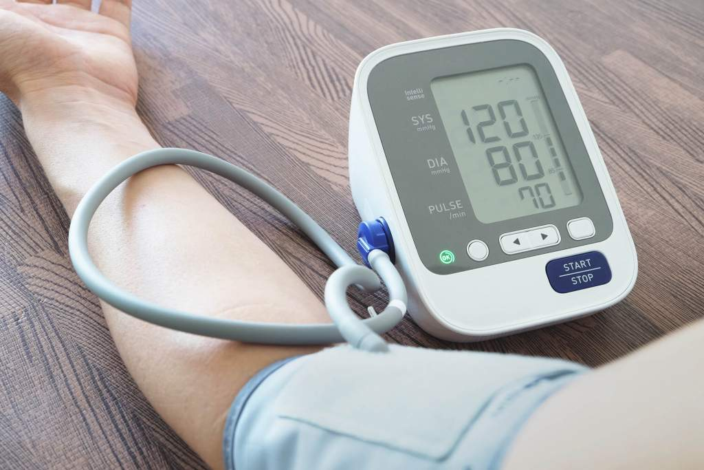 Blood pressure is measured using a device that fits over the arm